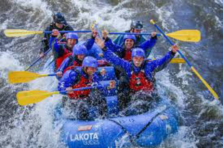Group white water rafting with Lakota Guides