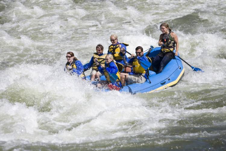 Friends on a white water raft in Colorado