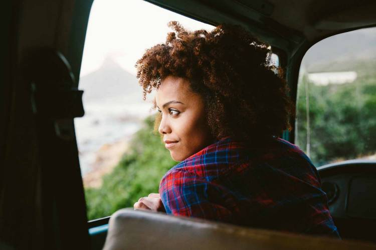 Woman looking out the window of a taxi