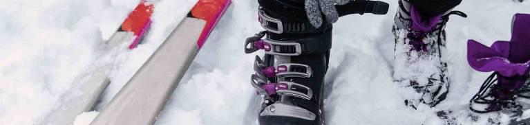 Woman putting on ski boots